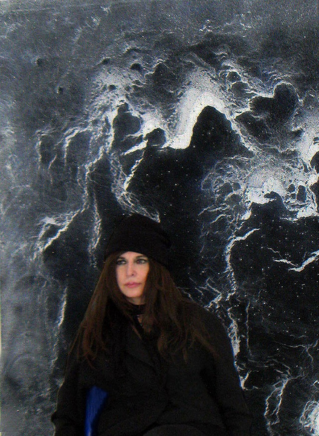 Artist in front of 'Stormy Water III' (detail)